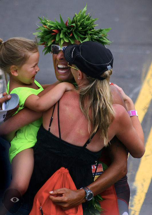 Professional triathlete Chris McCormack (4) happily hugs his family after winning the Ford Ironman World Championship 2010 from Kailua-Kona.