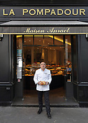 Dominique Anract, baker, holding a loaf of bread outside his bakery La Pompadour, on the Rue de la Tour in the 16th arrondissement of Paris, France. Dominique Anract comes from a family of bakers and this is his third bakery, where he employs 30 people and 8 apprentices, housed in a building built in 1868 under Napoleon III. He is also president of the Confederation Nationale de la Boulangerie-Patisserie Francaise, or National Confederation of French Bakery, tasked to protect the quality and integrity of French bakery and patisserie. Photographed on 16th January 2019 by Manuel Cohen