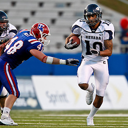 December 4, 2010; Ruston, LA, USA;  Nevada Wolf Pack quarterback Colin Kaepernick (10) runs past Louisiana Tech Bulldogs linebacker Dusty Rust (48) during the second half at Joe Aillet Stadium.  Nevada defeated Louisiana Tech 35-17. Mandatory Credit: Derick E. Hingle