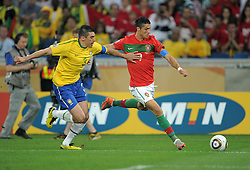 LUCIO defends against CRISTIANO RONALDO during the 2010 FIFA World Cup South Africa Group G match between Portugal and Brazil at Durban Stadium on June 25, 2010 in Durban, South Africa.