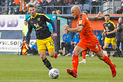 Luton Town midfielder Alan McCormack (4) and Oxford United forward James Henry (17) during the EFL Sky Bet League 1 match between Luton Town and Oxford United at Kenilworth Road, Luton, England on 4 May 2019.
