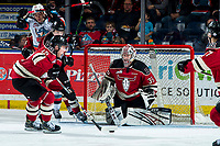 KELOWNA, BC - FEBRUARY 15: Josh Tarzwell #19 clears the puck after the rebound save by Byron Fancy #35 of the Red Deer Rebels against the Kelowna Rockets at Prospera Place on February 15, 2020 in Kelowna, Canada. (Photo by Marissa Baecker/Shoot the Breeze)