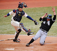 Kelly Shopach tags out Joe Crede at home plate in the eighth inning Monday, March 31 at Progressive Field in Cleveland. The Indians defeated the White Sox 10-8.
