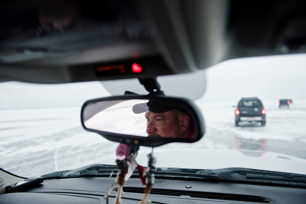 PIPE, WI -FEB. 16, 2015: David Koball, 44, of Elkhart Lake, drives roughly two miles on the ice to his shanty, following a row of other truck drivers and spear fishermen Monday, Feb. 16, 2015. 13,000 licenses were sold for the 2015 sturgeon spearing season, and 233 fish were caught Monday between all of the registration stations, with 62 being registered in Stockbridge. The season started Feb. 14, 2015 and lasted until Feb. 21, 2015 on Lake Winnebago with a total of 1870 sturgeon speared. The average success rate for spearers is 10-12% and some people go years without spotting anything from their shanty. Lauren Justice for The New York Times