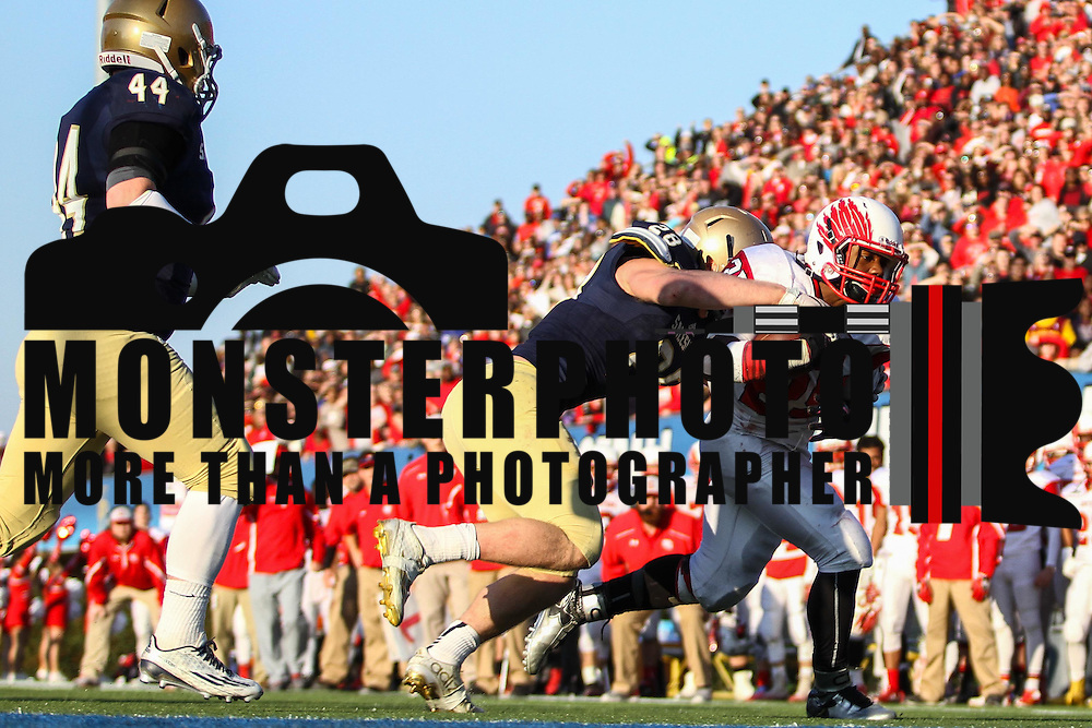 Smyrna running back William Knight (25) is tackled by Salesianum linebacker Colby Reeder (28) in the fourth quarter during a DIAA Division I championship game between Smyrna and Salesianum Saturday, Dec. 05, 2015 at Delaware Stadium in Newark.