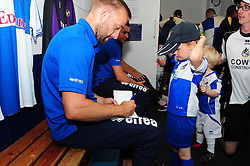 A young fan gets an autograph signed - Photo mandatory by-line: Dougie Allward/JMP - Tel: Mobile: 07966 386802 21/07/2013 - SPORT - FOOTBALL - Bristol -  Bristol Rovers Fun Day