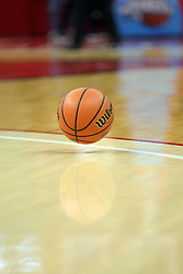 a basketball bounces on a gym floor