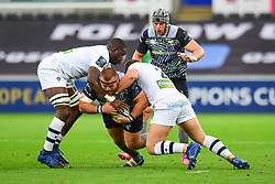Ospreys' Dimitri Arhip is tackled by Clermont Auvergne's Benjamin Kayser - Mandatory by-line: Craig Thomas/JMP - 15/10/2017 - RUGBY - Liberty Stadium - Swansea, Wales - Ospreys Rugby v Clermont Auvergne - European Rugby Champions Cup