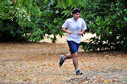 &copy; Licensed to London News Pictures. 30/07/2018<br /> GREENWICH, UK.<br /> A man jogging with brown leaves on the ground.<br /> A cloudy grey day in London, Greenwich Park, Greenwich.<br /> Photo credit: Grant Falvey/LNP
