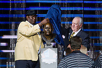 07 August 2010: Former New Orleans Saints linebacker  Rickey Jackson and New Orleans Saints owner Tom Benson reveal Jackson's HOF bust at the Pro Football Hall of Fame in Canton, Ohio.