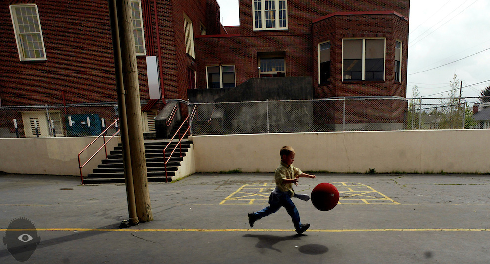 A child runs with a ball during recess at Grout Elementary School in Portland, Oregon.