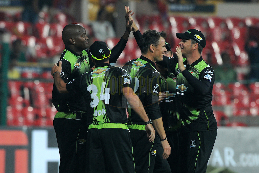 Johan Botha of Warriors celebrate a wicket during match 1 of the NOKIA Champions League T20 ( CLT20 )between the Royal Challengers Bangalore and the Warriors held at the  M.Chinnaswamy Stadium in Bangalore , Karnataka, India on the 23rd September 2011..Photo by Pal Pillai/BCCI/SPORTZPICS