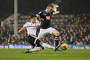 Fulham forward Lucas Piazon (20) tackling Derby County defender Alex Pearce (16) during the EFL Sky Bet Championship match between Fulham and Derby County at Craven Cottage, London, England on 17 December 2016. Photo by Matthew Redman.