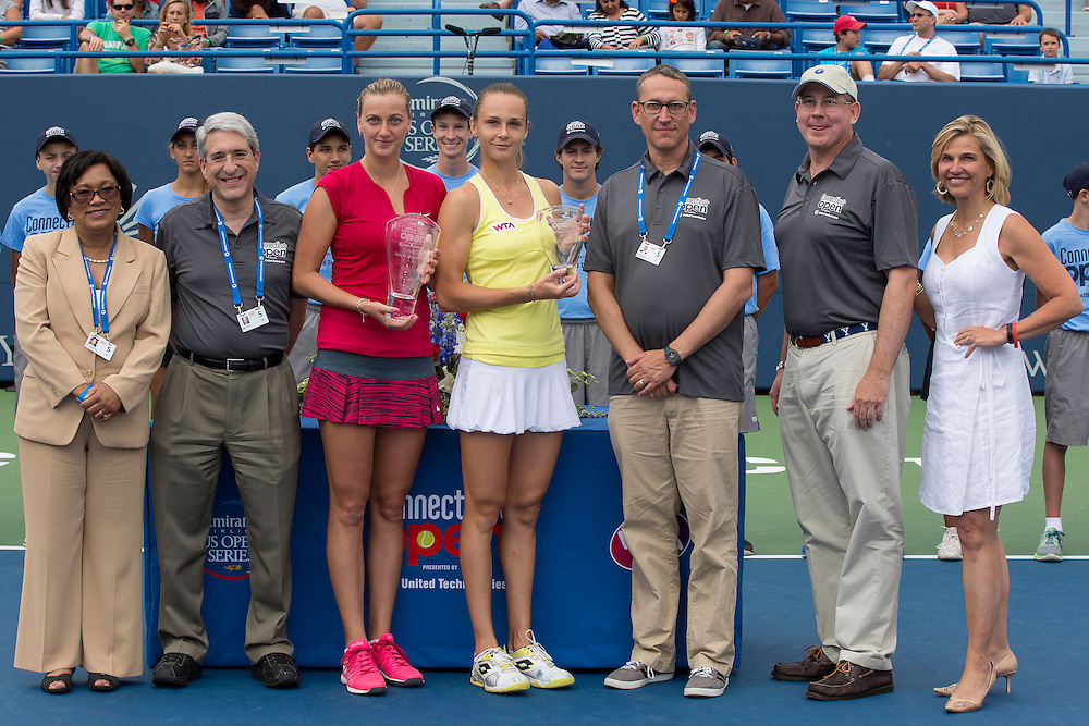 August 23, 2014, New Haven, CT:<br /> (From left to right) New Haven Mayor Toni Harp, Yale University President Peter Salovey, Singles Champion Petra Kvitova, Singles Finalist Magdalena Rybarikova, Ben Barnes of the State of Connecticut, Charlie Gill of United Technologies, and Tournament Director Anne Worcester pose for a photograph during a ceremony following the Singles Final on day nine of the 2014 Connecticut Open at the Yale University Tennis Center in New Haven, Connecticut Saturday, August 23, 2014.<br /> (Photo by Billie Weiss/Connecticut Open)