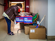 11 APRIL 2019 - AMES, IOWA:  A woman signs in to attend Eric Swalwell's town hall meeting on the campus of Iowa State University in Ames. Swalwell represents California's 15th District but is originally from Algona, Iowa. His appearance in Ames Thursday was his first appearance in Iowa since announcing his candidacy on April 8, although he made about 20 trips to Iowa since the 2016 election. Iowa traditionally hosts the the first election event of the presidential election cycle. The Iowa Caucuses will be on Feb. 3, 2020.     PHOTO BY JACK KURTZ