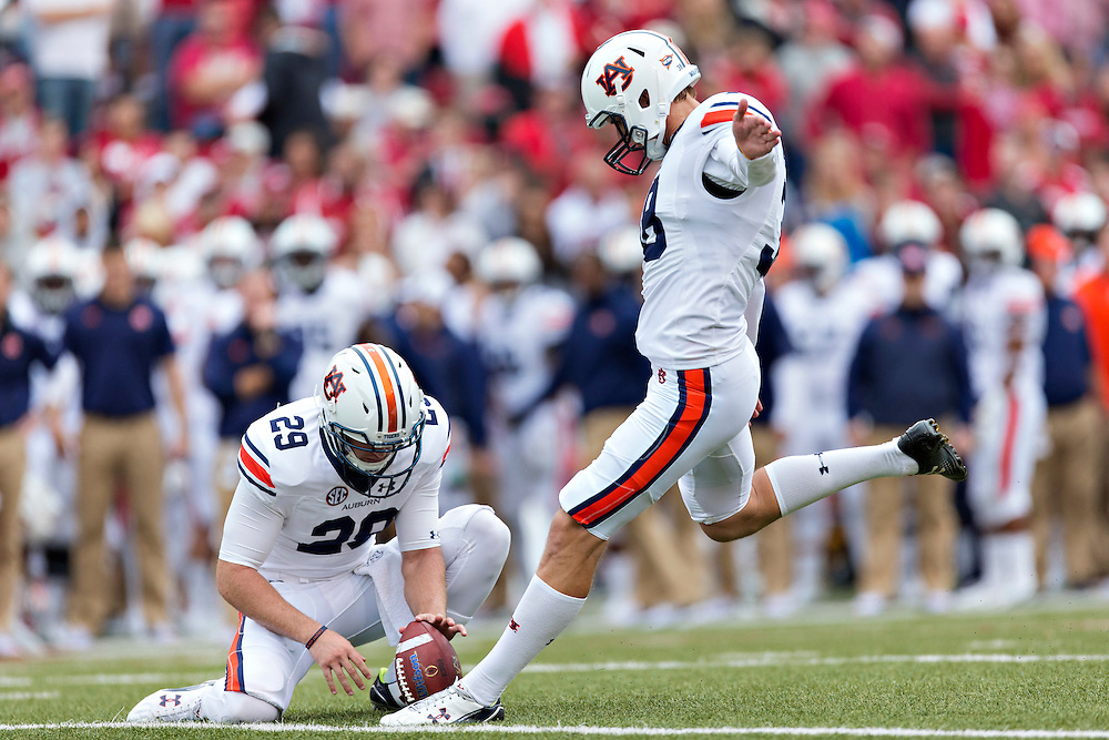 FAYETTEVILLE, AR - OCTOBER 24:  Daniel Carlson #38 of the Auburn Tigers kicks a field goal against the Arkansas Razorbacks at Razorback Stadium Stadium on October 24, 2015 in Fayetteville, Arkansas.  The Razorbacks defeated the Tigers in 4 OT's 54-46.  (Photo by Wesley Hitt/Getty Images) *** Local Caption *** Daniel Carlson