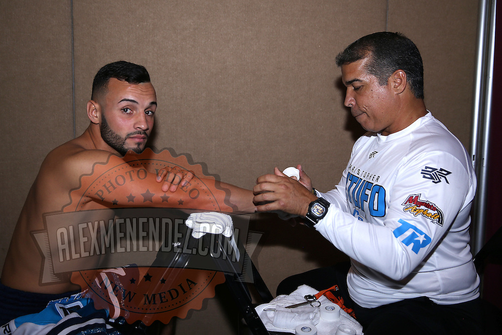 Christoper Diaz gets his hands wrapped in preparation for his fight with Raul Hirales during the Top Rank boxing event at Osceola Heritage Park in Kissimmee, Florida on September 22, 2016.