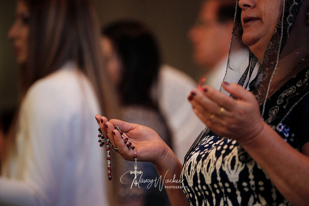 A woman prays during Mass with Holy Family Chaldean Catholic Mission at a Roman Catholic church in Phoenix Aug. 23, 2015. (Nancy Wiechec for ONE magazine)