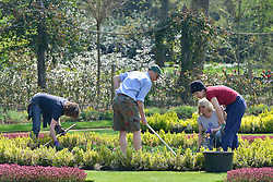 © Licensed to London News Pictures. 25/04/2013. Chiswick, UK Volunteers help prepare the ornamental gardens. People enjoy the sunshine in the grounds of Chiswick House in West London today 25th April 2013. Photo credit : Stephen Simpson/LNP