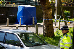 © Licensed to London News Pictures. 06/05/2018. London, UK. Police officers investigate at the scene where a 17-year-old boy has died after being shot on Cooks Road in Kennington, south London. Photo credit: Tolga Akmen/LNP
