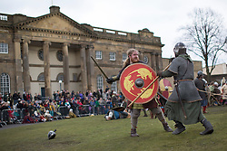 © licensed to London News Pictures. York, UK 23/02/2013. Re-enactment performers fighting a battle as Vikings and Anglo-Saxon knights next Clifford's Tower in York. Over 200 re-enactment performers take part at Jorvik Viking Festival 2013 in York. Photo credit: Tolga Akmen/LNP