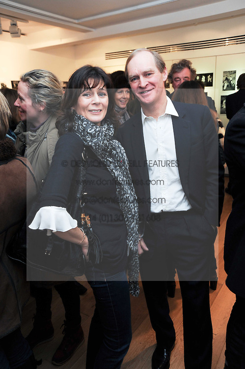 JAMES & LUCY HERVEY-BATHURST at a private view of photographs by Nick Ashley held at the Sladmore Gallery, 32 Bruton Place, London on 13th January 2010.