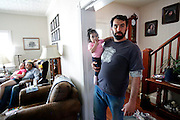 Adam Azevedo holds his niece Brooklyn as his father Tony Azevedo sits with his granddaughter Bryana, at left, in his home on the family dairy farm in Stevinson, Calif., on Sunday, March 23, 2014.  Tony plans to get out of the dairy business and focus on his event business, The Double T, which holds western themed weddings and parties. Adam, a third generation organic dairy farmer, would like to remain in the farm business, and is considering buying his own ranch.