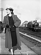 10/10/1952<br /> 10/10/1952<br /> 10 October 1952<br /> Miss Trudy Doyle, fashion special at a train station in Dublin. Note steam engine in background.