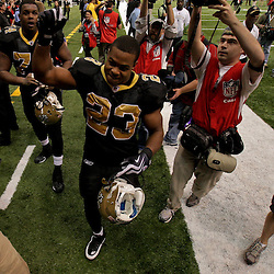 2009 November 02: New Orleans Saints running back Pierre Thomas (23) celebrates as he runs off the field following a 35-27 win over the Atlanta Falcons at the Louisiana Superdome in New Orleans, Louisiana.