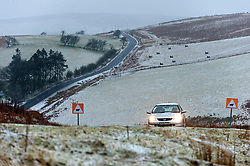 © Licensed to London News Pictures. 11/02/2017. Builth Wells, Powys, UK. A motorist drives through a winter landscape early this morning on the B4520 'Brecon Road' between Builth Wells and Brecon in Powys, Wales, UK. Photo credit: Graham M. Lawrence/LNP