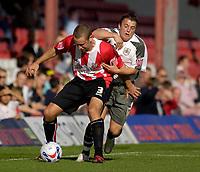 Photo: Daniel Hambury.<br />Brentford v Bristol City. Coca Cola League 1. 07/10/2006.<br />Brentford's Andy Frampton (L) and Bristol City's Scott Brown battle.
