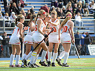 AMBLER, PA -  NOVEMBER 9: Gwynedd Mercy players celebrate Nicole Catalino's  goal in the second half of a playoff field hockey game between Archbishop Carroll and Gwynedd Mercy Academy at Wissahickon High School November 9, 2013 in Ambler Pennsylvania. (Photo by William Thomas Cain/Cain Images)