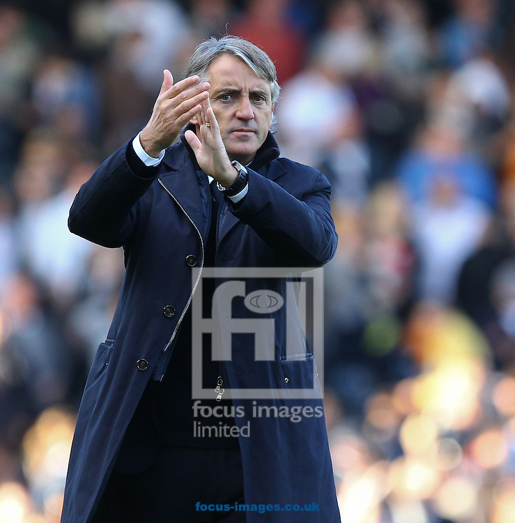 Picture by John  Rainford/Focus Images Ltd +44 7506 538356.29/09/2012.Roberto Mancini, manager of Manchester City applauds the away support at the end of the Barclays Premier League match at Craven Cottage, London.