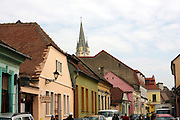 Romania, Transylvania, Biertan, village street with well kept painted houses