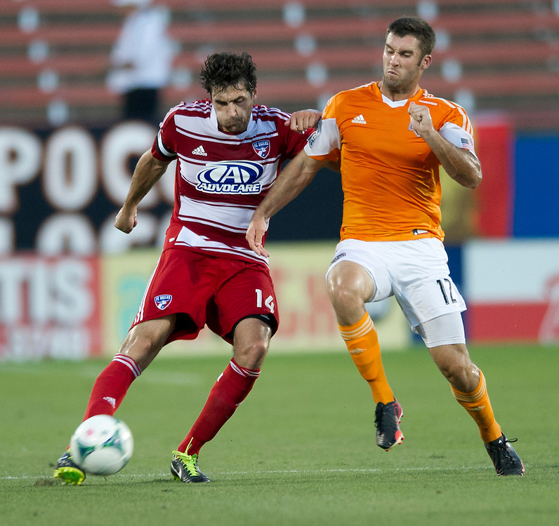 FRISCO, TX - JUNE 12:  George John #14 of FC Dallas and Will Bruin #12 of Houston Dynamo battle for the ball on June 12, 2013 at FC Dallas Stadium in Frisco, Texas.  (Photo by Cooper Neill/Getty Images) *** Local Caption ***  George John; Will Bruin
