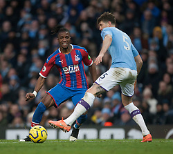 Wilfried Zaha of Crystal Palace (L) in action - Mandatory by-line: Jack Phillips/JMP - 18/01/2020 - FOOTBALL - Etihad Stadium - Manchester, England - Manchester City v Crystal Palace - English Premier League