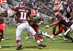 Louisiana-Lafayette running back Trey Ragas (9) rushes to the end zone for a touchdown against Texas A&M defensive back Larry Pryor (11) during the second quarter of an NCAA college football game Saturday, Sept. 16, 2017, in College Station, Texas. (AP Photo/Sam Craft)