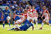Doncaster Rovers defender Tom Anderson (12) clears this cross during the EFL Sky Bet League 1 match between Peterborough United and Doncaster Rovers at London Road, Peterborough, England on 1 September 2018.