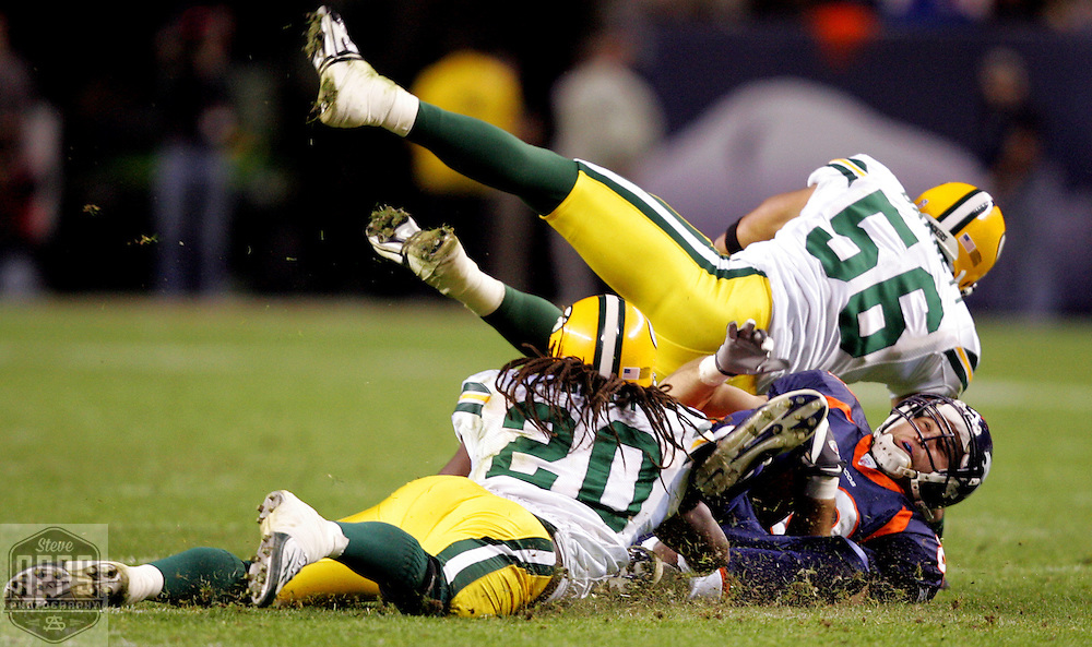 Green Bay Packers' Nick Barnett and Atari Bigby tackle Denver's Tony Scheffler in the 3rd quarter. .The Green Bay Packers traveled to Invesco Field in Denver to play the Denver Broncos in Monday Night Football, October 29, 2007. Steve Apps-State Journal.