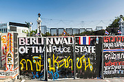 01 DECEMBER 2013 - BANGKOK, THAILAND: Anti-government graffiti on a wall near an anti-government protest site in Bangkok. Thousands of anti-government Thais confronted riot police at Phanitchayakan Intersection, where Rama I and Phitsanoluk Roads intersect, next to Government House (the office of the Prime Minister). Protestors threw rocks, cherry bombs, small explosives and Molotov cocktails at police who responded with waves of tear gas and chemical dispersal weapons. At least four people were killed at a university in suburban Bangkok when gangs of pro-government and anti-government demonstrators clashed. This is the most serious political violence in Thailand since 2010.    PHOTO BY JACK KURTZ