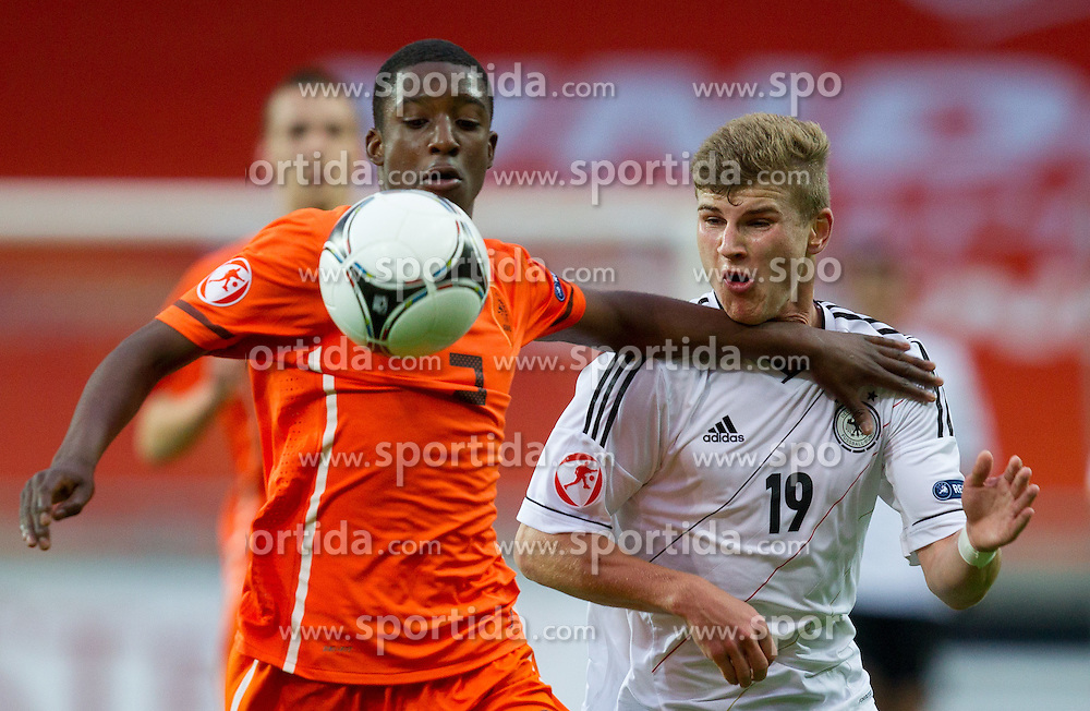 Riechedly Bazoer of Netherlands vs Timo Werner of Germany during the UEFA European Under-17 Championship Final match between Germany and Netherlands on May 16, 2012 in SRC Stozice, Ljubljana, Slovenia. Netherlands defeated Germany after penalty shots and became European Under-17 Champion 2012. (Photo by Vid Ponikvar / Sportida.com)