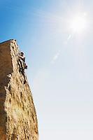 Woman Free Climbing on Cliff