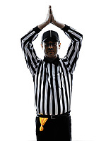 american football referee gestures safety in silhouette on white background
