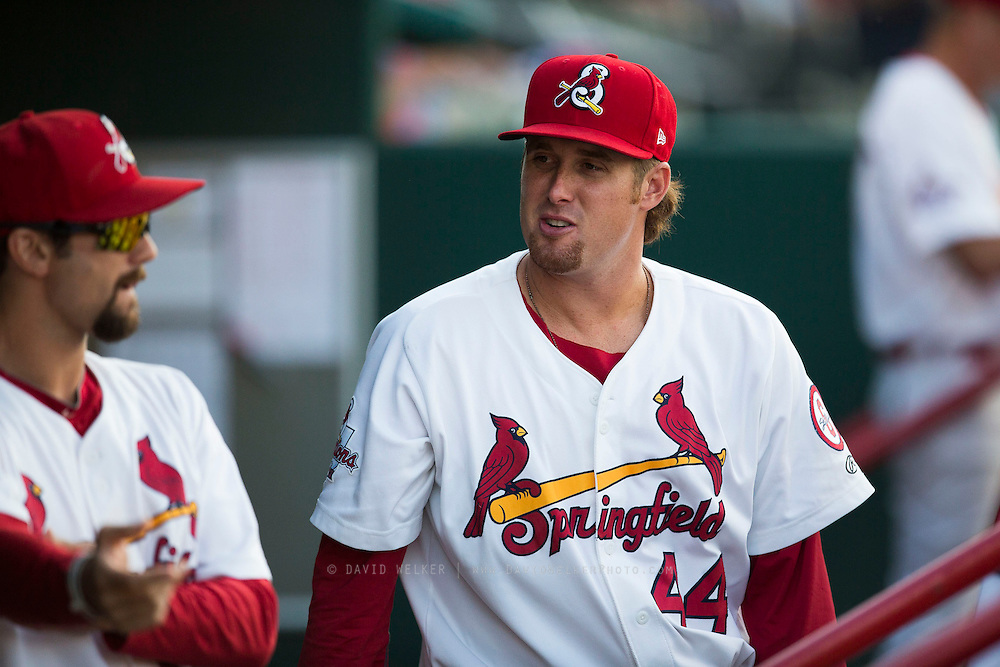 Anthony Ferrara (44) of the Springfield Cardinals talks with teammates in the dugout prior to a game against the Northwest Arkansas Naturals at Hammons Field on August 20, 2013 in Springfield, Missouri. (David Welker)