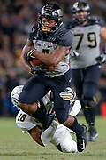 WEST LAFAYETTE, IN - SEPTEMBER 15: Rondale Moore #4 of the Purdue Boilermakers runs the ball after a catch as Joshuah Bledsoe #18 of the Missouri Tigers makes the tackle at Ross-Ade Stadium on September 15, 2018 in West Lafayette, Indiana. (Photo by Michael Hickey/Getty Images) *** Local Caption *** Rondale Moore; Joshuah Bledsoe NCAA Football - Purdue Boilermakers vs Missouri Tigers at Ross-Ade Stadium in West Lafayette, Indiana. Sports photographer by Michael Hickey