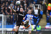 Matthew Pennington (5) of Leeds United battles for possession with Jon Dadi Boovarsson (23) of Reading during the EFL Sky Bet Championship match between Reading and Leeds United at the Madejski Stadium, Reading, England on 10 March 2018. Picture by Graham Hunt.