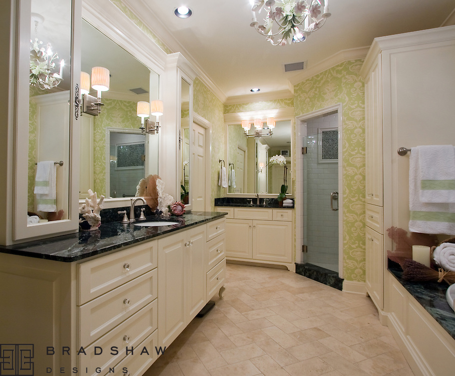 TERRELL MASTER BATH WITH HERRINGBONE PATTERN TRAVERTINE FLOORS, GREEN MARBLE COUNTERTOPS, HIS and HER VANITIES, MIRRORED CABINET DOORS AND GLASS KNOBS.