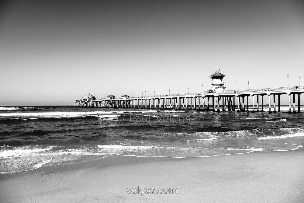Huntington Beach Pier black and white photo.  Huntington Beach Pier is a registered historic place.  Huntington Beach is also known as Surf City USA and is a seaside beach city along the Pacific Ocean in Southern California.