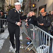 NEW YORK -- U.S. Navy Master-at-Arms 2nd Class Dallas Erickson of Minneapolis cheers up parade watchers at the 2017 New York City Veterans Day Parade.  Ericsson serves at Weapons Station, Earle NJ. <br /> Sailors from local Navy units are participating in the to honor the service of all our nation's veterans. #USNavy, #NavyInNYC, #VeteransDay, #USNavy, #VeteransDay #NeverForget (U.S. Navy photo by Chief Mass Communication Specialist Roger S. Duncan/ Released)