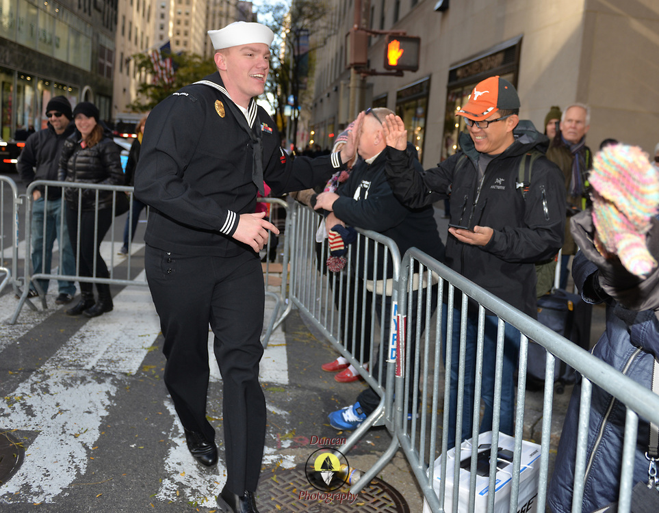 NEW YORK -- U.S. Navy Master-at-Arms 2nd Class Dallas Erickson of Minneapolis cheers up parade watchers at the 2017 New York City Veterans Day Parade.  Ericsson serves at Weapons Station, Earle NJ. <br /> Sailors from local Navy units are participating in the to honor the service of all our nation&rsquo;s veterans. #USNavy, #NavyInNYC, #VeteransDay, #USNavy, #VeteransDay #NeverForget (U.S. Navy photo by Chief Mass Communication Specialist Roger S. Duncan/ Released)